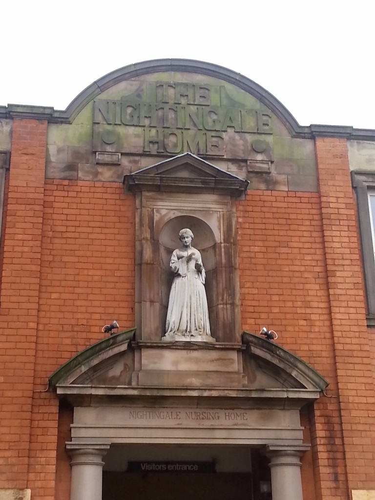 Statue above the door of the old nurses home.